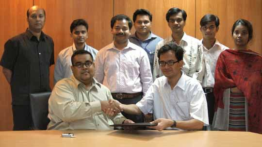 The official Agreement Signing Handshake between Citycell AVP Marketing (VAS) Mr. Ahmed Armaan Siddiqui and 3SM Systems representative Mr. Sujoy Kumar Chowdhury. Also present are Citycell officials (standing from left) Citycell AVP Engineering (VAS) Mr. Shamiul Haque, Mr. Abu Zaid Md. Hussain, Mr. Adnan Bin Taj and Mr. Shahrear Seraj. Right to them are 3SM members Mr. Hasan Shihab Uddin, Mr. Mahbubur Rahman and Ms. Nahid Mahfuza Alam.